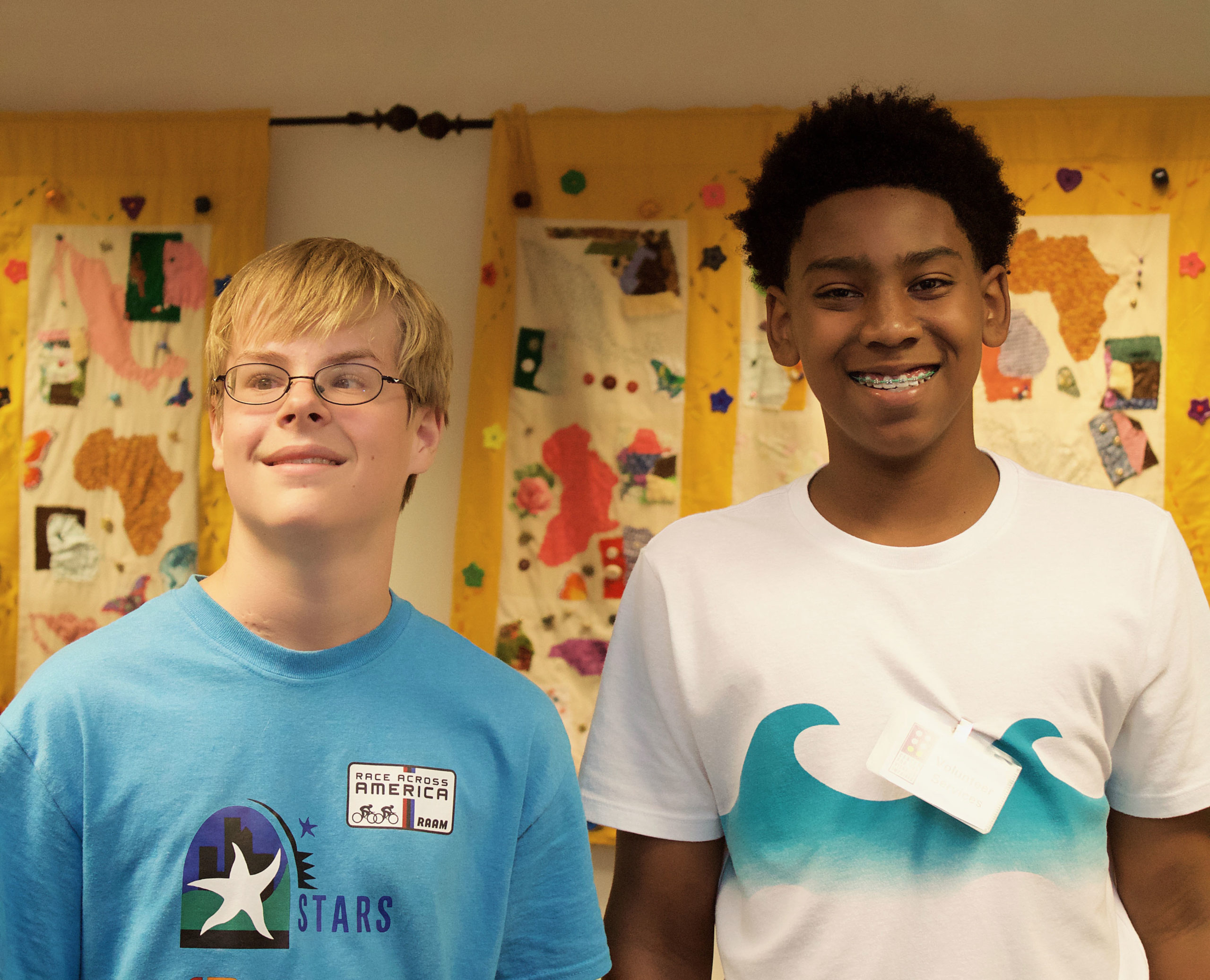 two young men that volunteer at CVI